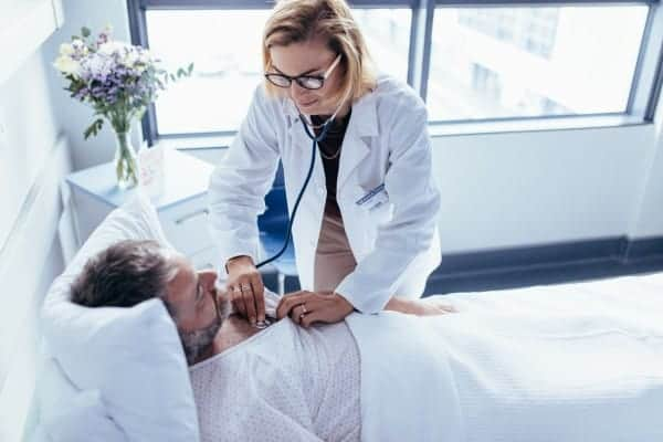 Doctor attending male patient for routine checkup
